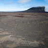 the crater of Eggoya rising from a barren lava landscape, Jan Mayen