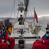 Jason at the helm with the island of Jan Mayen fading in the distance
