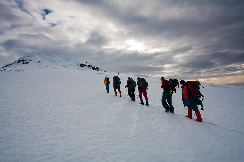 Ascending Beerenberg under clearing skies, Jan Mayen