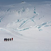 Climbing group ascending to the summit ridge of Beerenberg, Jan Mayen.