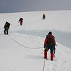 Crossing a crevasse just below the summit ridge of Beerenberg. Jan Mayen
