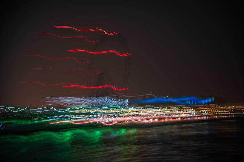 Leaving the port at Osaka, Japan. Ferris wheel abstract.