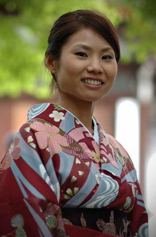 A lovely young woman at Ryoanji temple wearing a Kimono.