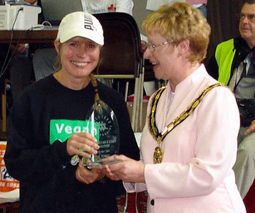 Fiona also won the 2007 Halstead marathon in 2007, shattering the 13 year course record by over 11 minutes. Here she's being presented with the Essex County Championship medal.