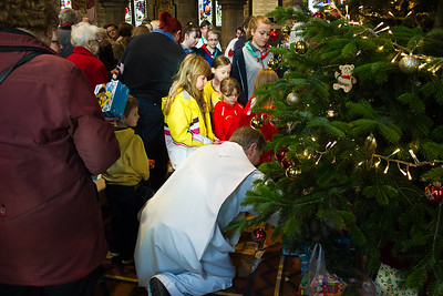 Advent 2 - Parade & Toy Service - Presents are placed under the tree for families who cannot afford to buy their own.