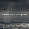 Two kitesurfers in a storm.