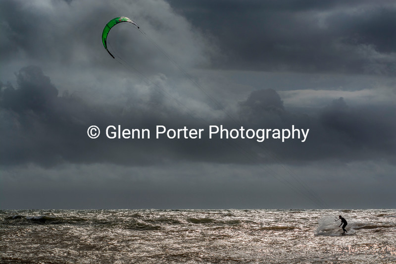Kitesurfing and storm clouds.