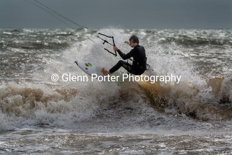 Kitesurfing off the lip, strapless, on the Isle of Wight, Brook Beach.
