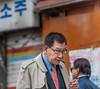 A man smokes a cigarette the Insa-dong neighborhood of Seoul, South Korea. (Jongno-gu, Seoul, KR - 03/27/13, 3:21:53 PM)