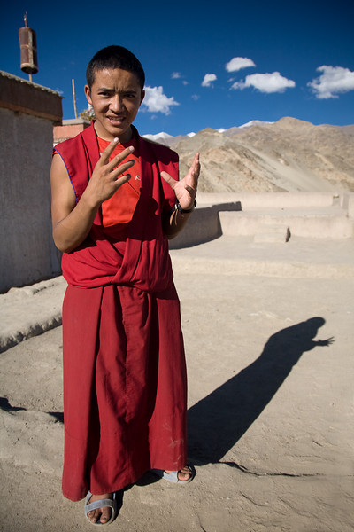 A novice monk explaining his faith. Thikse Gompa, Ladakh