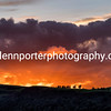 Sunset, fluffy clouds and trees on the horizon, Lake District.