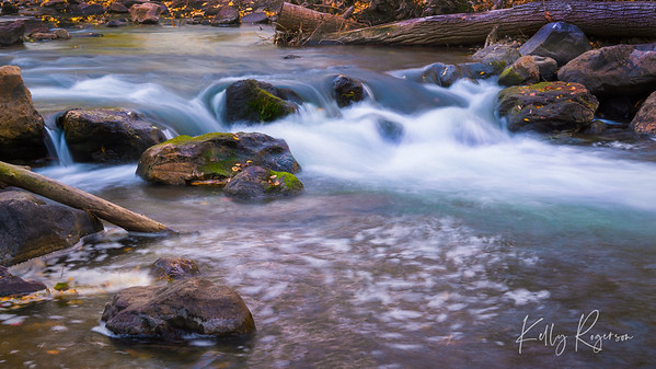 A crisp fall day watching the water flow over the mossy rocks at Ogden River in Ogden, Utah.