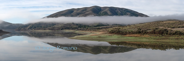 Lake with morning fog panorama