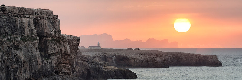 Nati lighthouse, Mallorca island & the sun