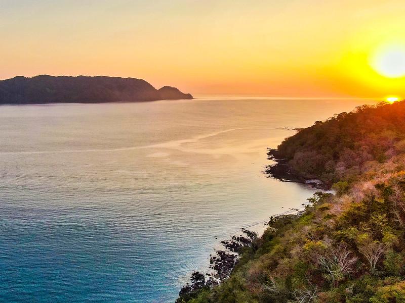 sunset on coast of sea