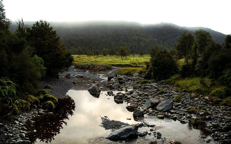 Misty Morning Over Stream