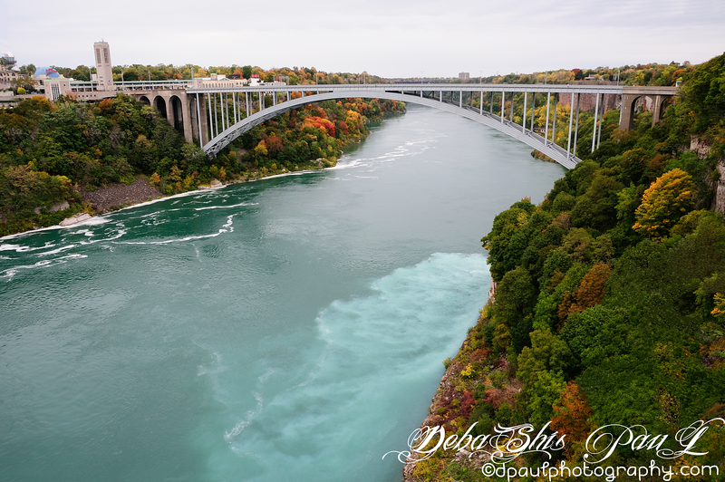 Rainbow Bridge that connects US to Canada - Taken from Prospect Point of Niagara Falls National Park, NYC - USA