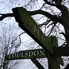 """The signpost landmark pointing to Coulsdon, Purley and Chaldon located near """"the"""" tree on Farthing Downs, Surrey"""