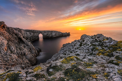 Natural stone bridge sunset