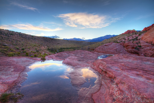 Same day as a rain shower in the morning over Red Rock Canyon provided a unique opportuntiy to capture the clouds reflecting on water which had collected on the rocks.