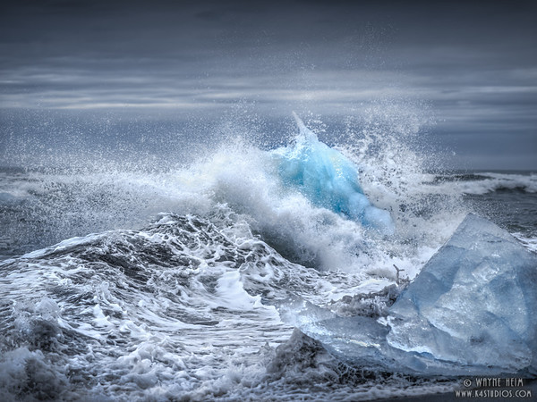 Waves Against Ice   Photography by Wayne Heim