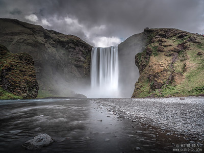 Skogafoss Waterfall From a Far   Photography by Wayne Heim