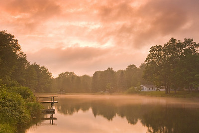 Evening mist rolls in on a pond in central Michigan