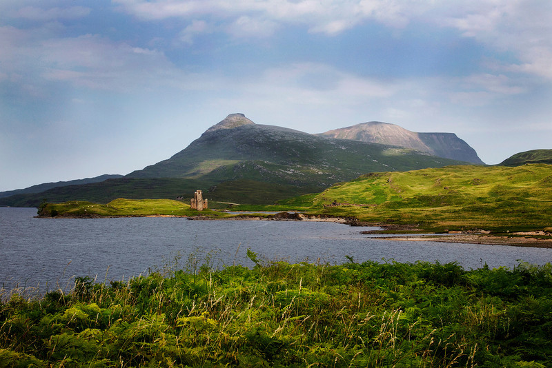Ardveck Castle with the Mountain Quinag behind.