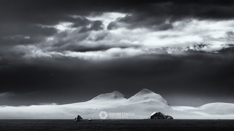 White snowy mountains under evening skies - Gerlache Strait, Antarctica
