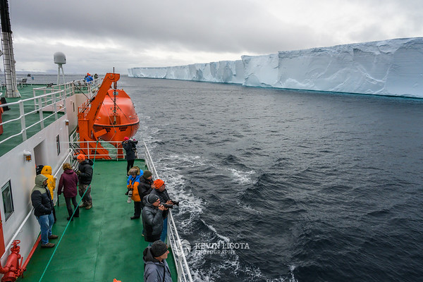 Photographers capture a tabular iceberg in the South Shetland Islands