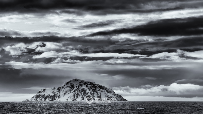 Snowy mountain under late night skies - Gerlache Strait, Antarctica