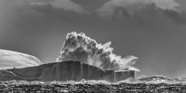 Waves from the Drake Passage crash over an iceberg