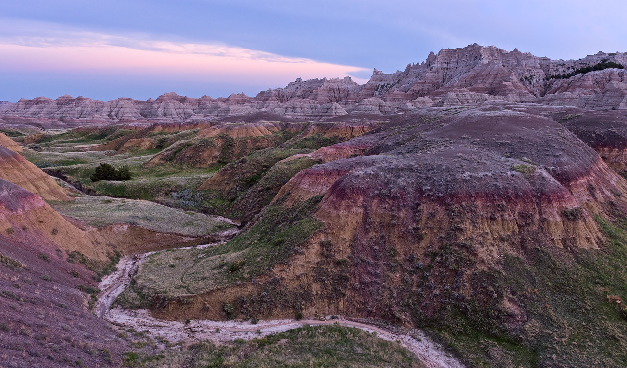 Sunset over yellow mounds