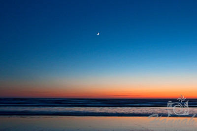 A crescent moon shot during dusk at Cannon Beach in the Oregon Coast  © Copyright Hannah Pastrana Prieto