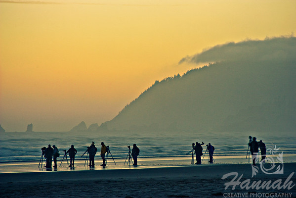 Row of photographers trying to take photos of the Haystack Rock before sunrise. Shot at Cannon Beach, Oregon Coast  © Copyright Hannah Pastrana Prieto