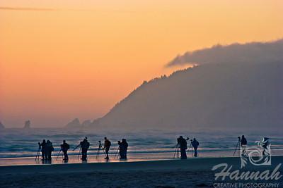 Row of photographers trying to take photos of the Haystack Rock before sunrise. Shot at Cannon Beach, Oregon Coast  © Copyright Hannah Pastrana Prieto