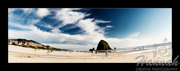 Panorama of Cannon Beach with a view of Haystack Rock in the Oregon Coast ... with black framed border.  © Copyright Hannah Pastrana Prieto