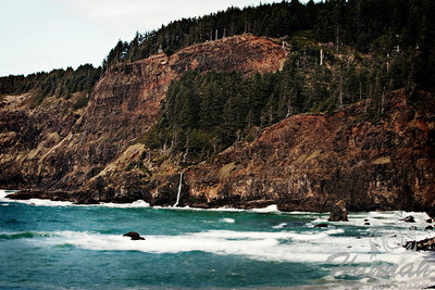 View of Cape Meares located in the Oregon Coast with a mini waterfall in the middle  © Copyright Hannah Pastrana Prieto