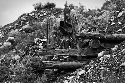 Old logs jut from the debris at an old iron mine.