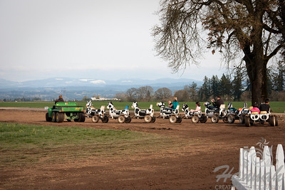 Children and parents riding a cow train at a tulip farm. Taken at Wooden Shoe Tulip Farm in Woodburn, OR   © Copyright Hannah Pastrana Prieto