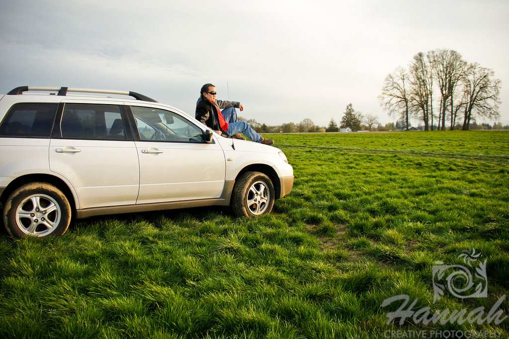 Man on top of a white vehicle at a grassy field.   © Copyright Hannah Pastrana Prieto