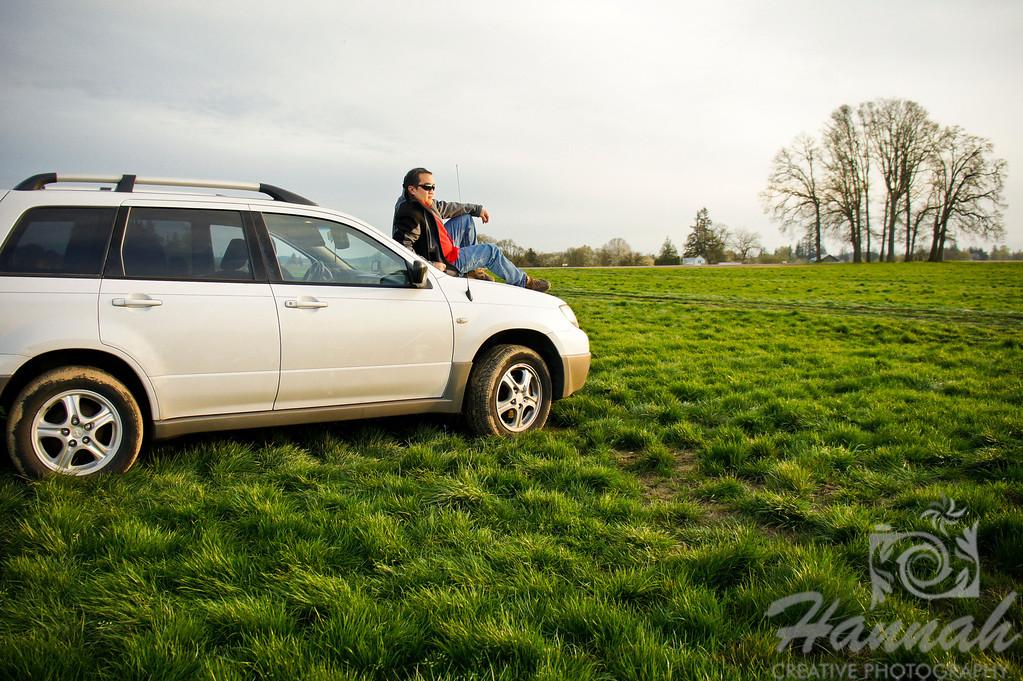 Man on top of a white vehicle at a grassy field.   © Copyright Hannah Pastrana Prieto