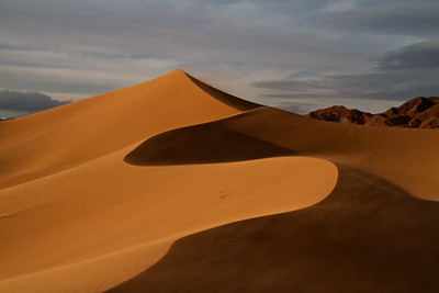 Sand blowing over the Ibex Dunes, Death Valley.
