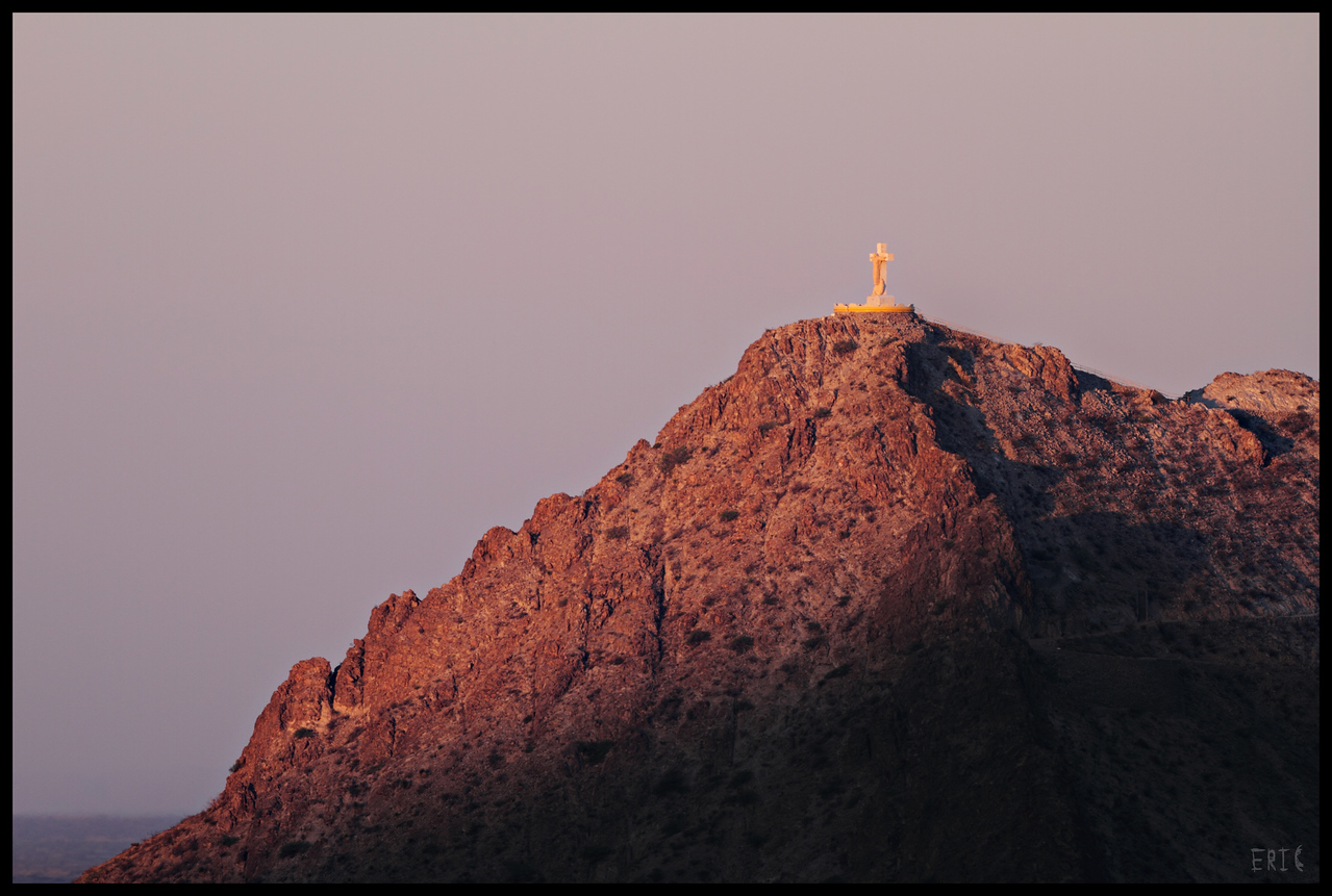 Illuminated<br /> <br /> Mount Cristo Rey at Sunrise, in El Paso, Texas <br /> <br /> Date: May 6, 2012<br /> <br /> Camera: Canon 7D<br /> Lens: Takahashi FSQ-106ED Apochromatic Refractor (530mm, f5)<br /> Filter:N/A<br /> Tripod: Quickset<br /> Exposure: ISO 100, 1/640 sec.