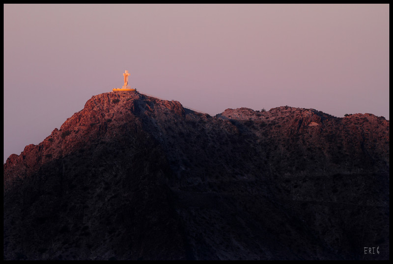 First Touch of Light<br /> <br /> Mount Cristo Rey at Sunrise, in El Paso, Texas <br /> <br /> Date: May 6, 2012<br /> <br /> Camera: Canon 7D<br /> Lens: Takahashi FSQ-106ED Apochromatic Refractor (530mm, f5)<br /> Filter:N/A<br /> Tripod: Quickset<br /> Exposure: ISO 100, 1/500 sec.
