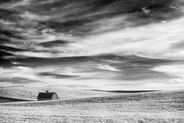 Lone Barn Under an Active Sky