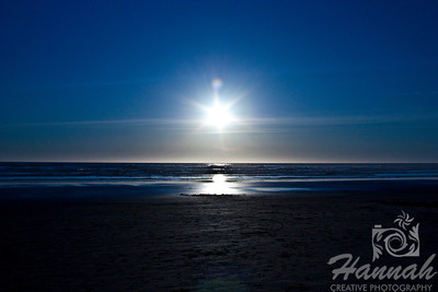 Waiting for sunset at the beach. Creative lens flare can be seen. Shot at Cannon Beach, Oregon Coast.  © Copyright Hannah Pastrana Prieto