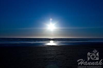 Waiting for sunset at the beach. Creative lens flare can be seen. Shot at Cannon Beach, Oregon Coast.  © Copyright Hannah Pastrana Prieto