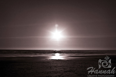 Waiting for sunset at the beach. In monochrome and creative lens flare can be seen. Shot at Cannon Beach, Oregon Coast.  © Copyright Hannah Pastrana Prieto