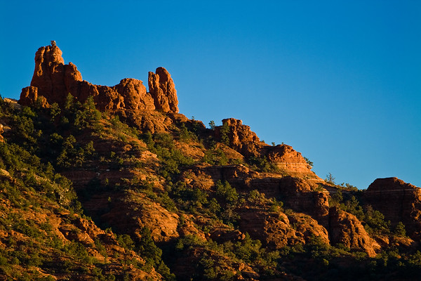 Setting sun lights up the cliffs at Sedona.
